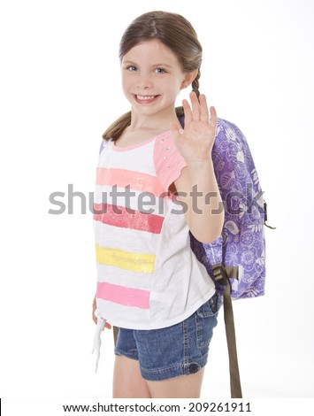 Happy little girl with backpack isolated on white waving goodbye - stock photo