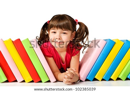 Happy little girl with books on the floor. Isolated on white - stock photo