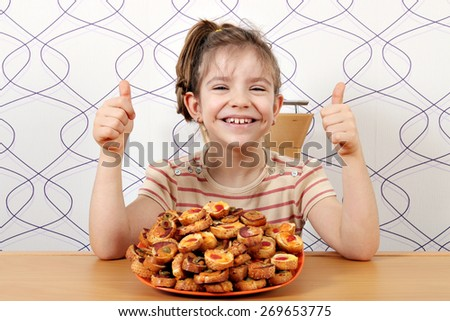 happy little girl with bruschette and thumbs up - stock photo