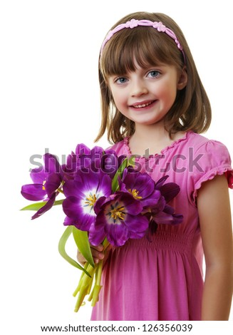 happy little girl with bunch of flowers - mothers day concept - stock photo