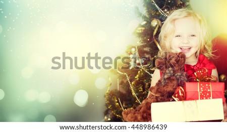 Happy little girl with christmas gift - stock photo