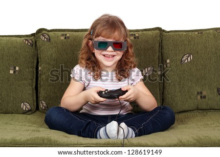 happy little girl with 3d glasses play video game - stock photo
