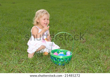 Happy Little Girl with Easter Basket - stock photo