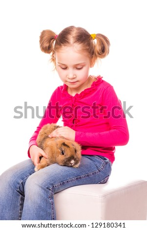 Happy little girl with easter bunny isolated on white. Happy Easter