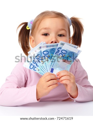 Happy little girl with few twenty euro banknotes, isolated over white