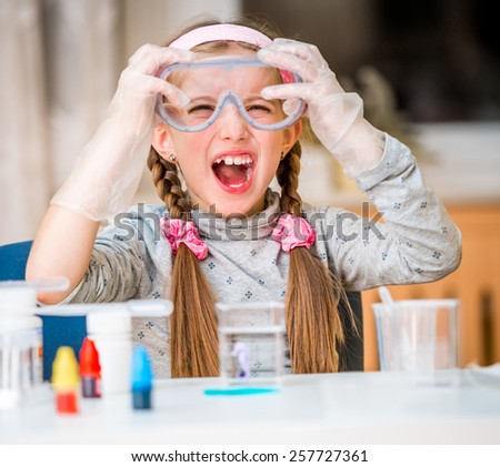 happy little girl with flasks for chemistry - stock photo