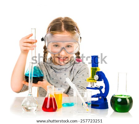 happy little girl with flasks for chemistry isolated on a white background - stock photo