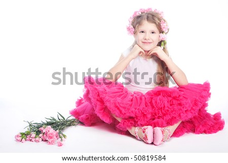 Happy little girl with flowers. studio set