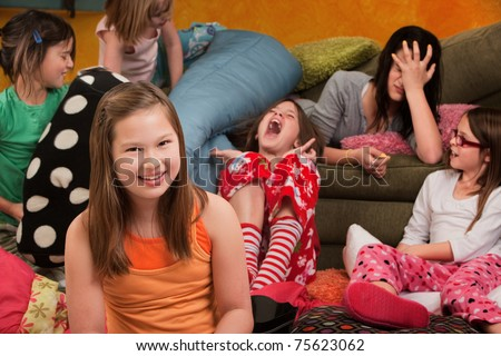 Happy little girl with friends at a sleepover - stock photo
