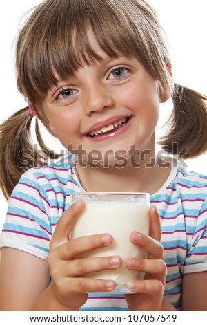 happy little girl with glass of milk - stock photo