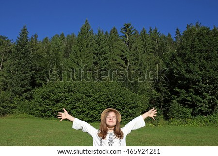 happy little girl with hands up enjoy in nature