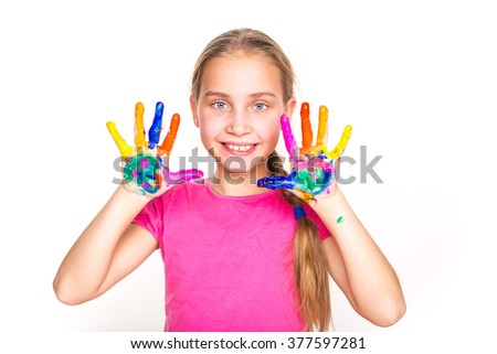 Happy little girl with her hands in paint isolated on white. Art concept