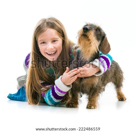 happy little girl with her pet dachshund in the studio on a white background