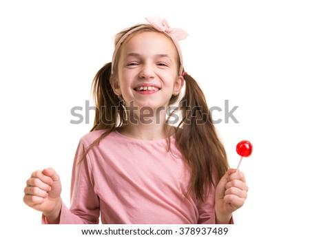 happy little girl with lollipop - stock photo