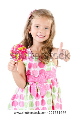 Happy little girl with lollipop and finger up isolated on a white - stock photo