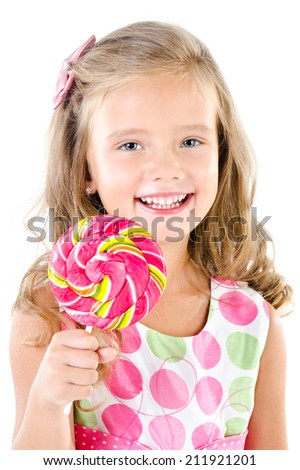 Happy little girl with lollipop isolated on a white