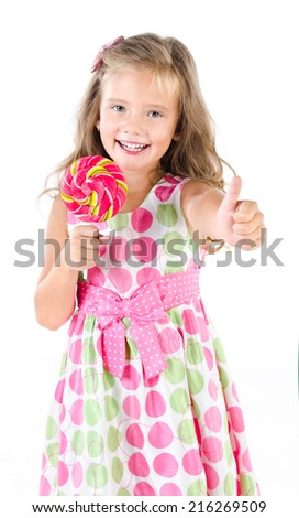 Happy little girl with lollipop isolated on white