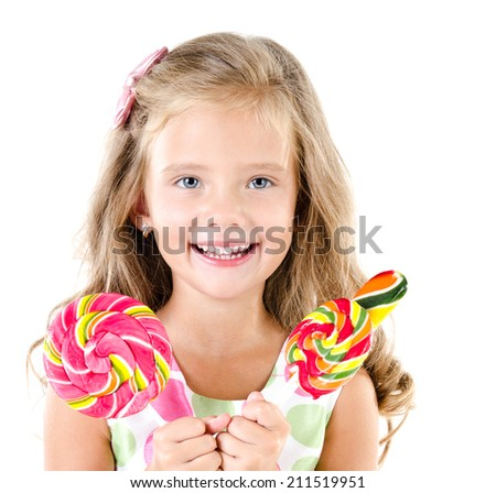 Happy little girl with lollipops isolated on a white - stock photo