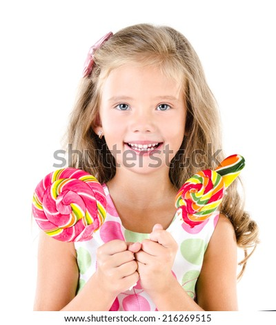 Happy little girl with lollipops isolated on white - stock photo