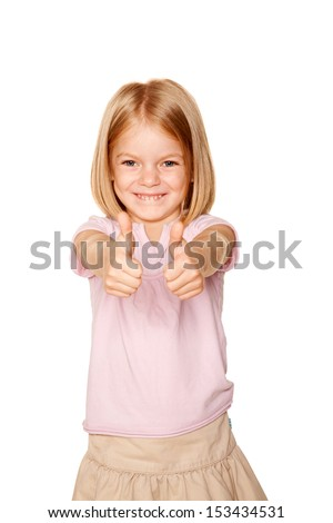 Happy little girl with pigtails showing a thumbs up sign or OK symbol. Isolated on white background - stock photo