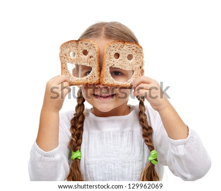 Happy little girl with plenty of food - welfare concept, isolated - stock photo