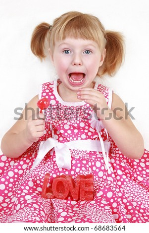 Happy little girl with red candle on white background
