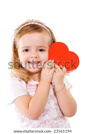 Happy little girl with red valentines heart - isolated