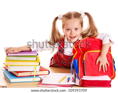 Happy little girl with school supplies and book. Isolated. - stock photo