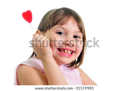 happy little girl with sweet isolated on the white background