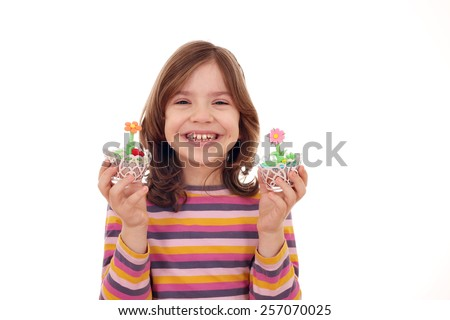 happy little girl with sweet muffin - stock photo