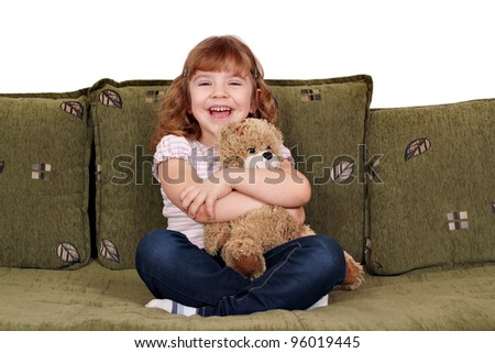 happy little girl with teddy-bear - stock photo