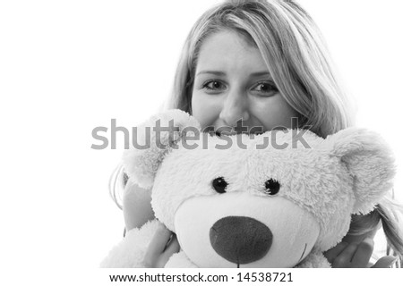 Happy little girl with teddy bear on a bedroom isolated on white background - stock photo