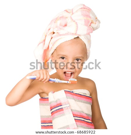 Happy little girl with toothbrush. Beautiful caucasian model. Isolated on white background. - stock photo