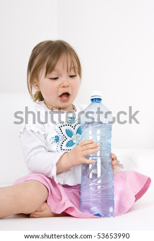 happy little girl with water