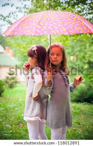 Happy little girlfriends in park - stock photo