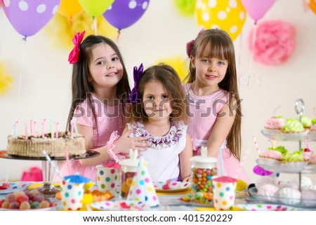 Happy little girls at birthday party - stock photo