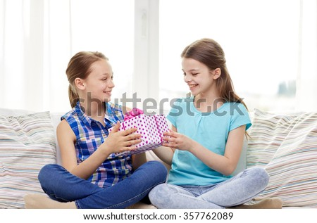 happy little girls with birthday present at home - stock photo