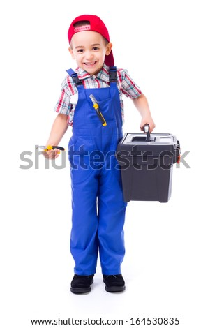 Happy little handyman boy carrying big toolbox and pliers - stock photo