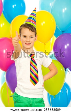 Happy little kid boy with colorful balloons on birthday party. Holidays concept.  - stock photo