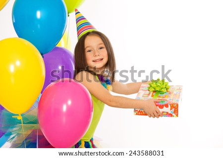 Happy little kid girl with gift box and colorful balloons on birthday party. Isolated on white background. olidays concept. - stock photo