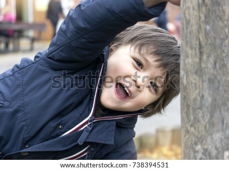 Happy little kid having fun playing on wooden in playground, Adorable boy smiling to camera while playing with friends, Happy and Healthy children concept