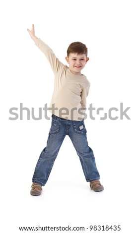 Happy little kid posing over camera, smiling. - stock photo