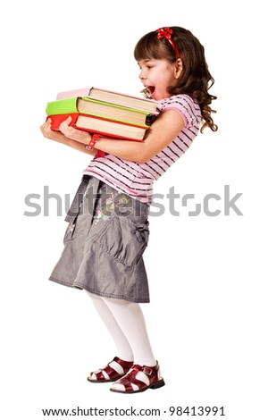 Happy little schoolgirl with a stack of heavy books. Isolated over white - stock photo