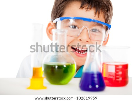 Happy little scientist playing at the lab - isolated over a white background - stock photo