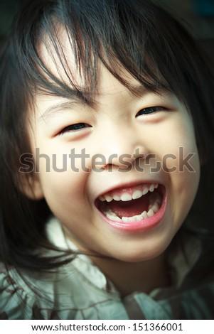 Happy Little Thai girl - stock photo