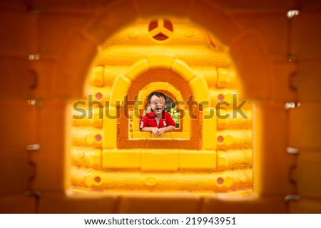 Happy little three years old child. A very cute young boy looking at camera. Image of funny and joyful beautiful little kid on a playground. Happy childhood, healthy and happiness concept. - stock photo