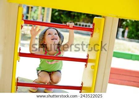 happy little  toddler girl on the playground - stock photo