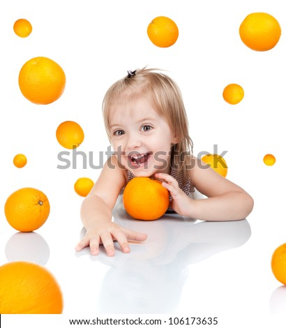 Happy little 2 year girl smile with orange, cute child sitting at table looking at camera oranges fly around isolated over white background, concept of vitamin fruit - stock photo