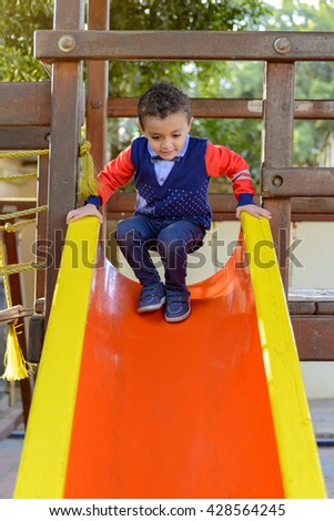 Happy Little Young Child Playing at Kids Park - stock photo