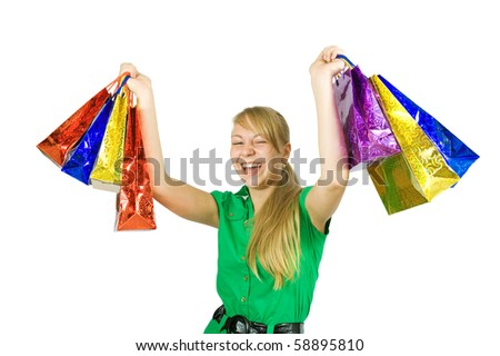 Happy long-haired girl holding shopping bags. Isolated over a white background
